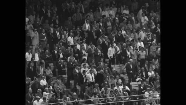 panning shot of audience clapping hands while watching world series baseball game between the dodgers and the twins at dodger stadium - 10 seconds or greater stock videos & royalty-free footage