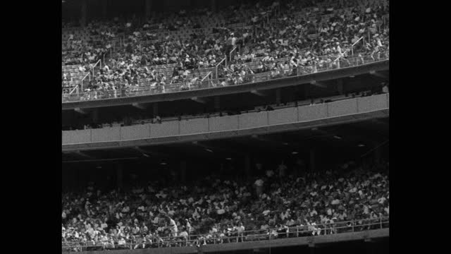 panning shot of audience watching baseball players playing game in dodger stadium, chavez ravine, los angeles, california, usa - 20 seconds or greater stock videos & royalty-free footage