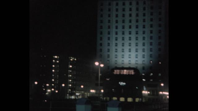 panning shot of bally's atlantic city hotel and casino and the claridge hotel at night, atlantic city, new jersey, usa, 1980 - atlantic city stock videos & royalty-free footage