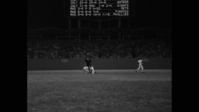 panning shot of baseball game, dodger stadium, los angeles, california, usa - four people stock videos & royalty-free footage