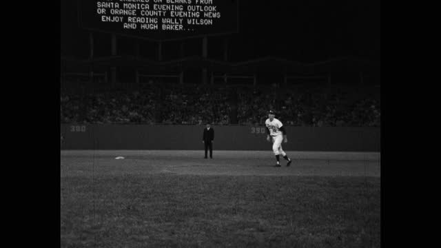 panning shot of baseball pitcher throwing ball, dodger stadium, los angeles, california, usa - medium group of people stock videos & royalty-free footage