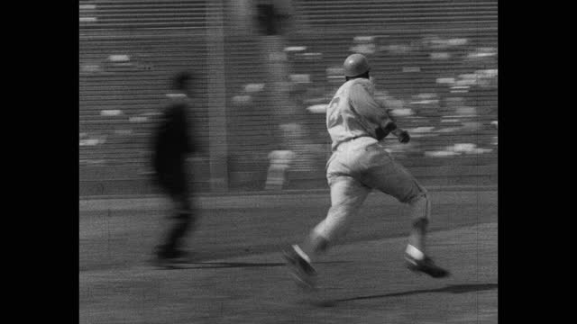 panning shot of baseball player completing home run during game - fielder stock videos & royalty-free footage