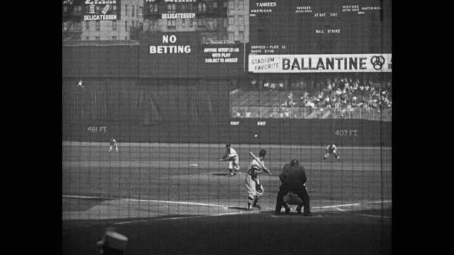 panning shot of baseball player hitting pop fly out during game, yankee stadium, new york city, new york, usa - fielder stock videos & royalty-free footage