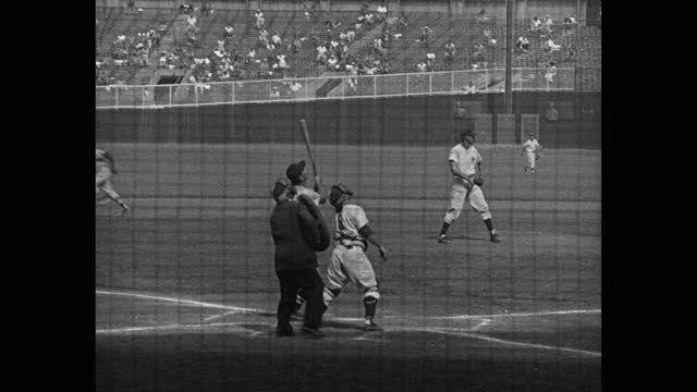 panning shot of baseball player popping up during game between the yankees and orioles, yankee stadium, new york city, new york, usa - fielder stock videos & royalty-free footage