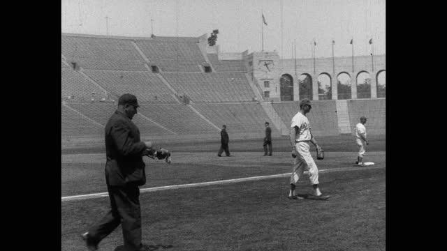 panning shot of baseball players and baseball umpire walking on baseball diamond - baseball strip stock videos & royalty-free footage