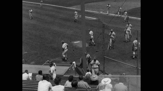 panning shot of baseball players getting ready to play game on baseball diamond - 20 seconds or greater stock videos & royalty-free footage