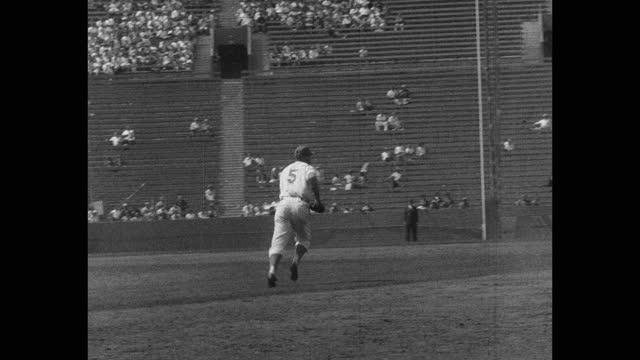 panning shot of baseball players playing game on baseball diamond - baseball strip stock videos & royalty-free footage