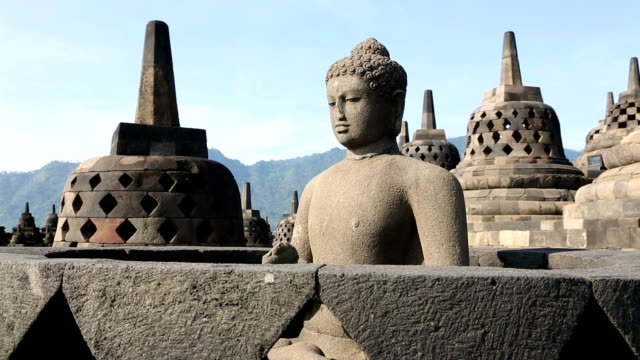 panning shot of buddha statue at borobudur temple hd video - antiquities stock videos and b-roll footage