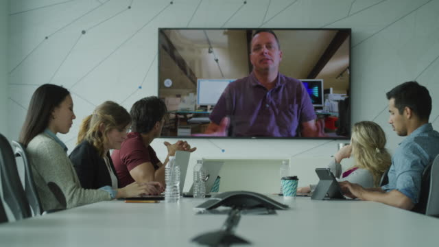 panning shot of business people in video conference meeting / pleasant grove, utah, united states - ビデオ点の映像素材/bロール