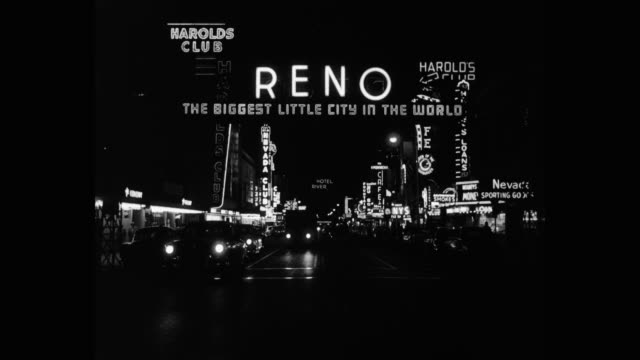 1955 panning shot of car pulling camper trailer in city at night, reno, nevada, usa - casino people stock videos & royalty-free footage