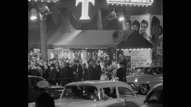panning shot of cars arriving at premiere of giant, los angeles, california, usa - filmpremiere stock-videos und b-roll-filmmaterial