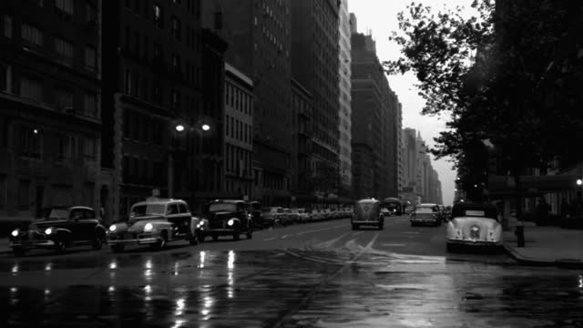 panning shot of cars driving on street in city, park avenue, new york city, new york state, usa - 1941 stock videos & royalty-free footage