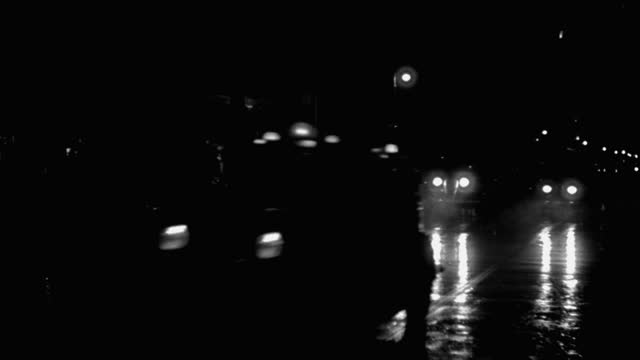 panning shot of cars driving on wet street at night, park avenue, new york city, new york state, usa - 1941 stock videos & royalty-free footage