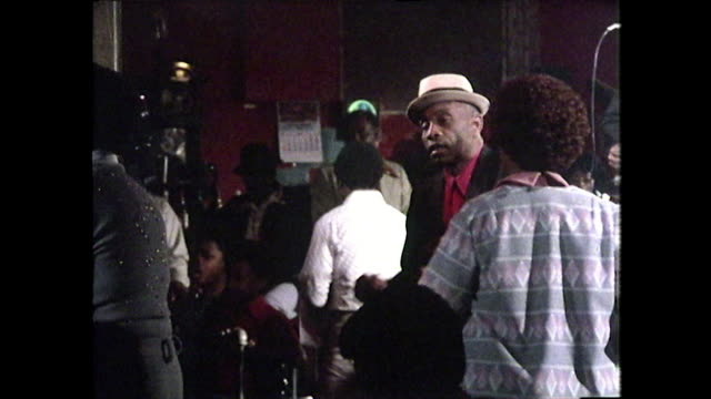 panning shot of chicago blues club with people dancing; 1976 - warm clothing stock videos & royalty-free footage