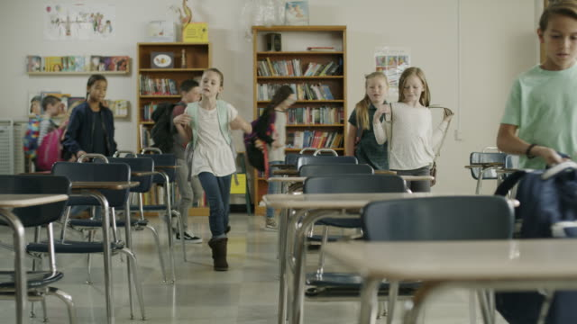 panning shot of children arriving for start of class in elementary school / provo, utah, united states - klassenzimmer stock-videos und b-roll-filmmaterial