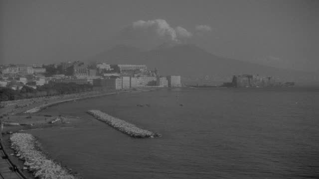 panning shot of city by sea with mount vesuvius appears in the distance from naples, italy - 1936 stock videos & royalty-free footage