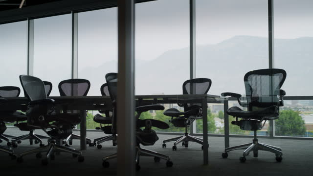 panning shot of conference room with scenic view of mountain range / pleasant grove, utah, united states - board room stock videos & royalty-free footage