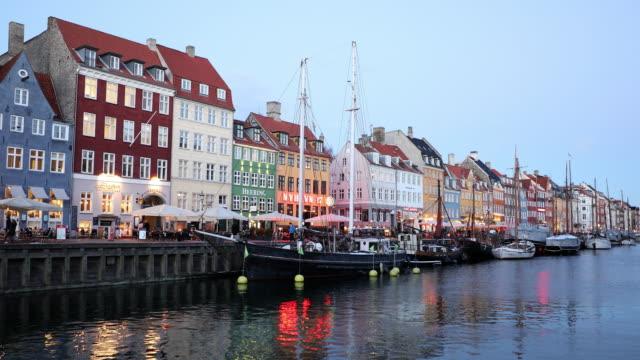 panning shot of copenhagen nyhavn new port of denmark - copenhagen stock videos and b-roll footage