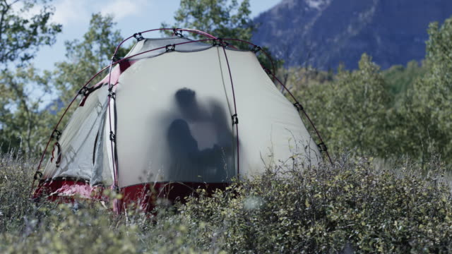 panning shot of couple kissing in tent at campsite / american fork canyon, utah, united states - american fork canyon stock videos and b-roll footage