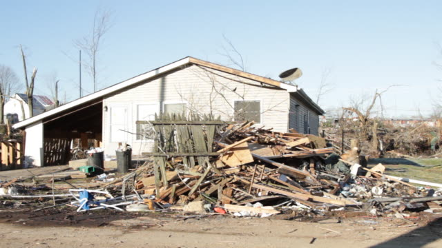 panning shot of destroyed house and debris piles - emergencies and disasters stock videos and b-roll footage