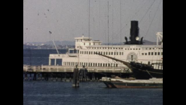 vidéos et rushes de panning shot of ferries by the pier; seagulls the sky - organisme aquatique