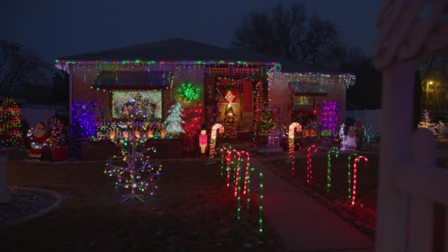 panning shot of festive house with christmas decorations illuminated at night / american fork, utah, united states - christmas lights stock videos & royalty-free footage