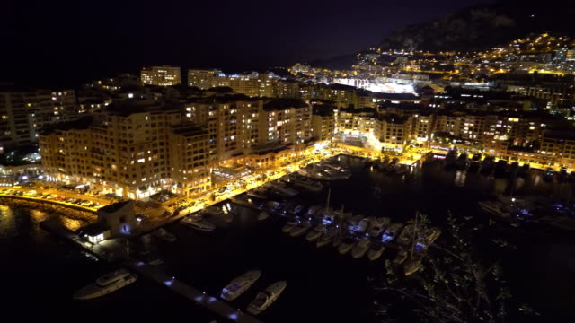 panning shot of fontvieille monaco monaco french riviera night - monaco stock videos & royalty-free footage