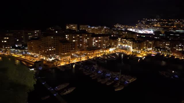 panning shot of fontvieille monaco monaco french riviera night - casino night stock videos & royalty-free footage