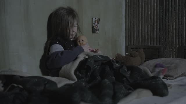 panning shot of girl sitting on mattress on floor holding doll / cedar hills, utah, united states - corner stock videos & royalty-free footage
