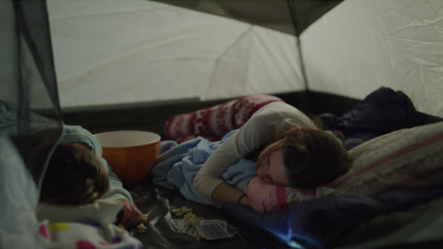 panning shot of girls sleeping in tent during sleep over / cedar hills, utah, united states - slumber party stock videos and b-roll footage