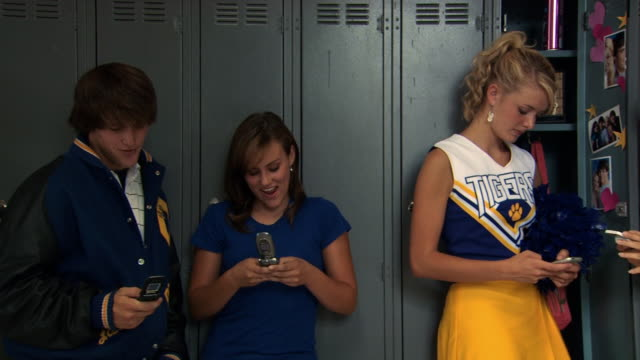 panning shot of high school students on cell phones - see other clips from this shoot 1148 stock videos and b-roll footage