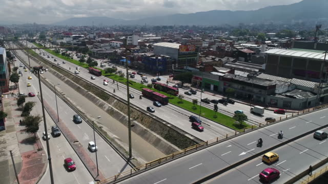 panning shot of land vehicles moving on highways in city, bogota, colombia - bogota stock videos & royalty-free footage