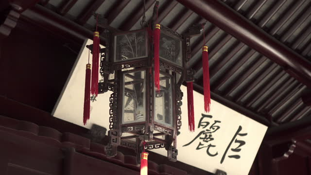 panning shot of lantern with red tassel hanging from roof against chinese text - suzhou, china - tassel stock videos & royalty-free footage