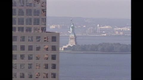 stockvideo's en b-roll-footage met panning shot of lower manhattan of the destruction on 9/11. - world trade center manhattan