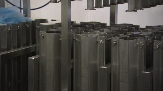 panning shot of machines for pressing cheese - guter zustand stock-videos und b-roll-filmmaterial