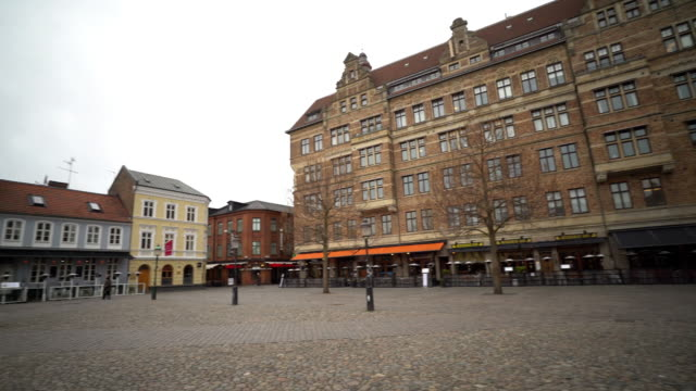 Panning Shot of Malmo downtown Little square Lilla Torg Sweden