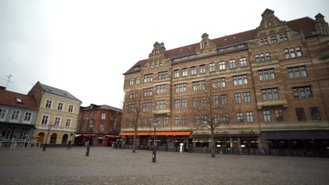 panning shot of malmo downtown little square lilla torg sweden - town square stock videos and b-roll footage