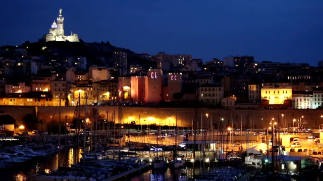 panning shot of Marseille city with old Vieux Port night