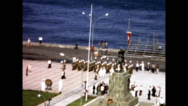 panning shot of military parade by the ocean; aerial shot; statue of man on horse - 1960 1969 stock videos & royalty-free footage