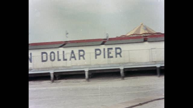 panning shot of million dollar pier, atlantic city, new jersey, usa, 1980 - atlantic city stock videos & royalty-free footage