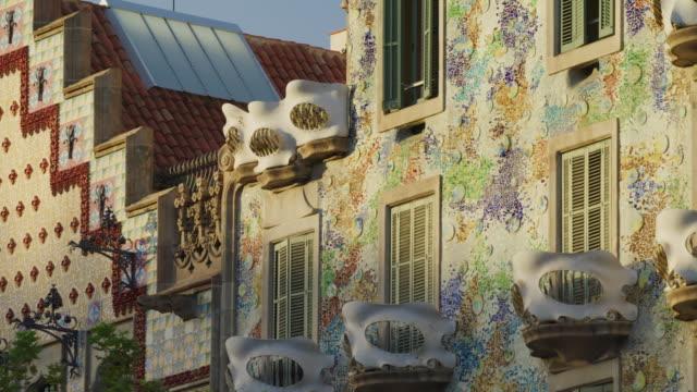 panning shot of mosaic tiles and sculpted balconies on casa batllo / barcelona, barcelona, spain - barcelona spain stock videos & royalty-free footage