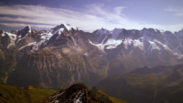 panning shot of mountain peaks in switzerland - snowcapped mountain stock videos and b-roll footage