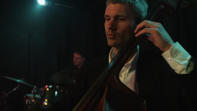 panning shot of musician playing cello / provo, utah, united states,  - provo stock videos & royalty-free footage