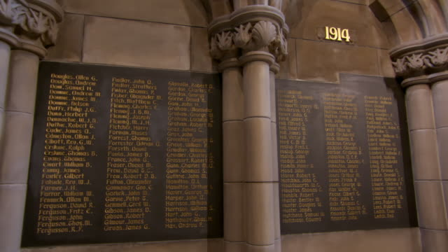 panning shot of names on placard mounted over wall at university - glasgow, scotland - placard stock videos & royalty-free footage