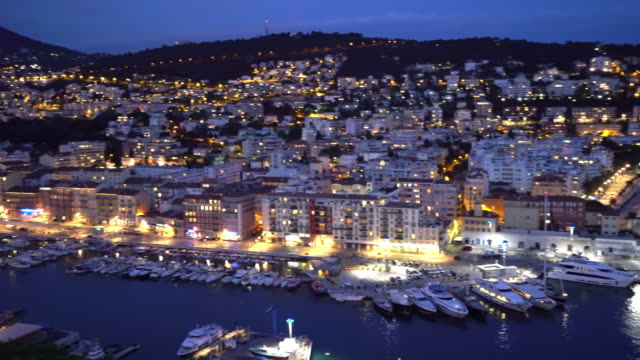 panning shot of nice marina port french riviera france night - promenade stock videos & royalty-free footage