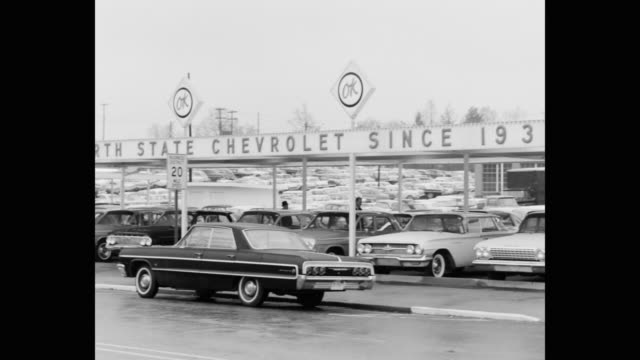panning shot of north state chevrolet car dealership, greensboro, nc, usa - car showroom stock videos & royalty-free footage