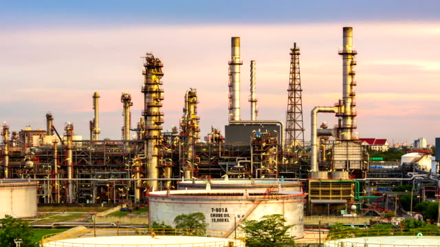 Panning shot of Oil Refinery ,Day to Night