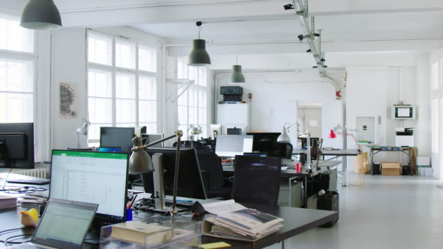 panning shot of open plan office - empty stock videos & royalty-free footage