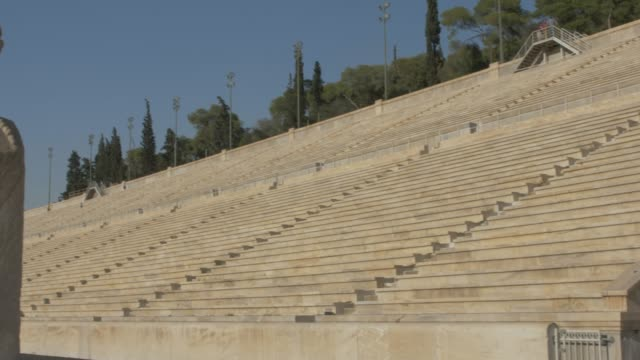 Panning shot of Panathenaic Stadium restored for the first modern Olympics in 1896, Athens, Greece, Europe
