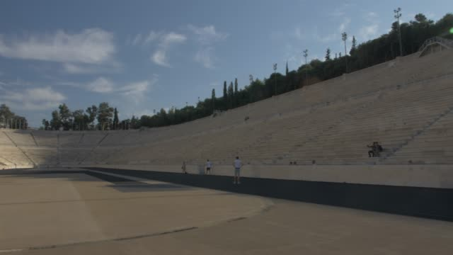 panning shot of panathenaic stadium restored for the first modern olympics in 1896, athens, greece, europe - circa 6th century stock videos & royalty-free footage